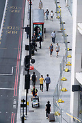 Seen from the elevation from the Marble Arch Mound, pedestrians walk along the southern end of Edgeware Road, on 11th August 2021, in London, England.