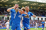 Peterborough United forward Jason Cummings (35) celebrates his goal with team mates during the EFL Sky Bet League 1 match between Peterborough United and Luton Town at London Road, Peterborough, England on 18 August 2018.