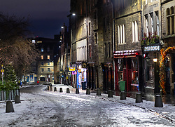 Edinburgh, Scotland, UK. 31 December 2020. Scenes of empty streets at night on Hogmanay in Edinburgh City Centre.Pre Covid-19 pandemic , the city was famous for its street entertainment on New Year's Eve and attracted many thousands of tourists every year to enjoy the New Year celebrations. Pic; The Grassmarket with its many pubs is deserted.  Iain Masterton/Alamy Live News