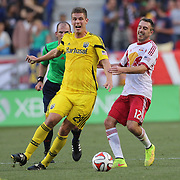 Adam Bedell, (left), Columbus Crew, is challenged by Eric Alexander, New York Red Bulls, during the New York Red Bulls Vs Columbus Crew, Major League Soccer regular season match at Red Bull Arena, Harrison, New Jersey. USA. 12th July 2014. Photo Tim Clayton