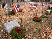 14 DECEMBER 2019 - DES MOINES, IOWA: Veterans graves with Christmas wreaths on them. Volunteers working with Wreaths Across America placed Christmas wreaths on the headstones of more than 600 US military veterans in Woodland Cemetery in Des Moines. The cemetery, one of the first in Des Moines, has the graves of veterans going back to the War of 1812.        PHOTO BY JACK KURTZ