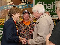 Senator Jeanne Shaheen speaks with Lee and David Hart of Laconia during the Laconia Firefighters Support rally at the American Legion on Monday evening.  (Karen Bobotas/for the Laconia Daily Sun)