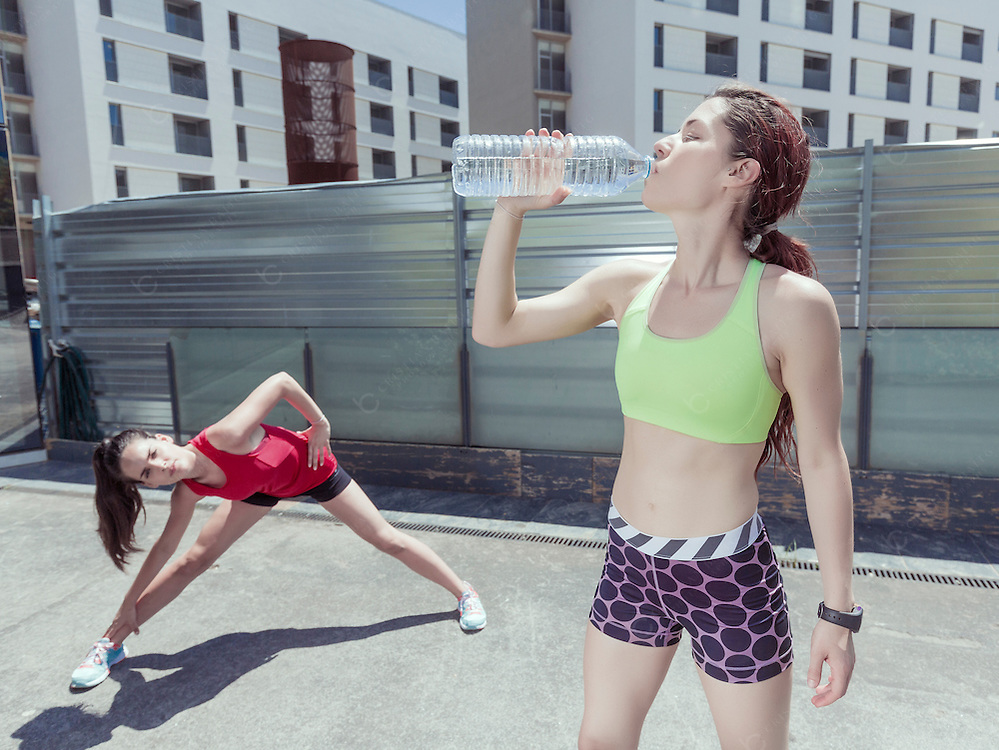 Women exercising and drinking water