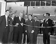 10/05/1962<br /> 05/10/1962<br /> 10 May 1965<br /> Opening of Smiths Motor Group Garage Athy, Co. Kildare. Picture shows the Minister for Agriculture, Mr. Patrick Smith, (third from left) cutting the tape after he had officially declared the garage opened; also in the picture are Mr. C.A. Smith, (fifth from left) Chairman of the Smith Motor Group; Mr John Beatly (second from left) Chief Inspector, Dept. of Agriculture; Mr. P.A. Duggan, (extreme right) Director Smith Motor Group; Mr John Perry, (left) Manager of Athy Garage, Smith Motor Group;Mr. A.C. Preston (4th from left) Sales Manager, Caltex (Ireland) Ltd. and mr. B. O'Kelly (2nd from right), David Brown Ltd.