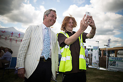 © Licensed to London News Pictures. 31/07/2015. Leeds , UK . NIGEL FARAGE poses for selfies at the CLA GameFair ( Country Landowners Association ) at Harewood House in Yorkshire . Photo credit: Joel Goodman/LNP