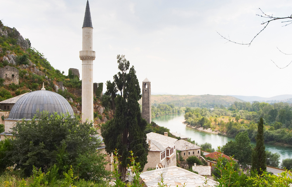 View over the town with mosque and church towers. River Neretva. Pocitelj historic Muslim and Christian village near Mostar. Federation Bosne i Hercegovine. Bosnia Herzegovina, Europe.