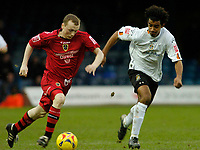 Photo: Leigh Quinnell.<br /> Luton Town v Cardiff City. Coca Cola Championship. 01/01/2007. Cardiffs Willo Flood gets away from Lutons Richard Langley.