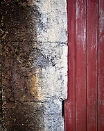 Detail of faded paint and rust on a door of a fisherman's cottage in the Faroe Islands. The Faroes are a photographer's delight. Much less visited than Iceland, they have their own character - check my other landscape gallery for more from these amazing islands. © Andrew Tobin www.tobinators.com