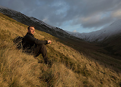 © Licensed to London News Pictures. 30/12/2014.  Elidir Fawr, Wales.   A walker enjoys one of the peaks in the Snowdon National Park today.  Photo credit : Alison Baskerville/LNP