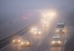 © Licensed to London News Pictures. 27/11/2020. Cobham, UK. Light traffic on the M25 on a foggy morning near Cobham in Surrey. Parts of the UK are experiencing freezing weather and low temperatures. Photo credit: Peter Macdiarmid/LNP