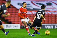 Jacob Brown of Barnsley (33) passes the ball during the EFL Sky Bet League 1 match between Barnsley and Bradford City at Oakwell, Barnsley, England on 12 January 2019.