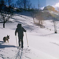 A cross country skier approaches Magura village in the Carpathian Mountains.