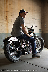 Eric Stein on his custom 1964 FLH Panhead bobber built by Eric in his home garage on setup day at the Congregation Show in Charlotte, NC. USA. Friday April 13, 2018. Photography ©2018 Michael Lichter.