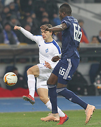 February 21, 2019 - Kiev, Ukraine - Dynamo Kyiv's Mykola Shaparenko (L) fights for the ball with Olympiacos Pape Abou Cisse (R) during the UEFA Europa League round of 32 second leg football match between Olympiacos FC and FC Dynamo Kyiv at the Olimpiyskiy Stadium in Kiev on February 21, 2019. (Credit Image: © Str/NurPhoto via ZUMA Press)