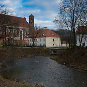 Vilnia river near Uzupis, St. Anne's Church on background, Vilnius, Lithuania