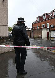 Police at the scene in Thornton Heath, south London, where a 15-year-old boy was stabbed to death last night.