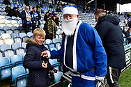 Blue Pompey Santa giving out sweets to the kids ahead of the EFL Sky Bet League 1 match between Portsmouth and Ipswich Town at Fratton Park, Portsmouth, England on 21 December 2019.