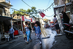 May 5, 2017 - °Zmir, Türkiye - Turkish gypsies in Izmir celebrate the coming of spring Hidrellez. Aegean district in Izmir city is a small  neighbourhood in where Turkish gypsy community lives. They celebrate the traditioanl spring festival Hidrellez every year. They wear their most beautiful clothes to celebrate Hidrellez. Hidrellez which signifies coming of spring has been celeberated by gypsies in great enthusiasm. The celebrations have kept going until late hours on May 5th, in Turkey. (Credit Image: © Depo Photos via ZUMA Wire)