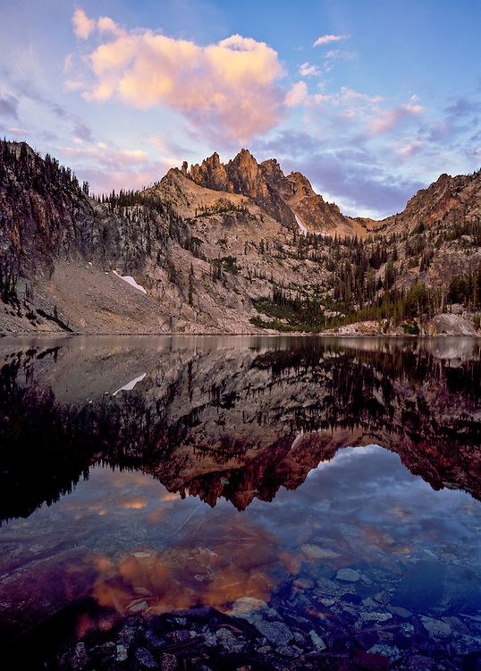 Heyburn Peak at 10229 feet 3118 meters reflects in the 4th Bench Lake above Redfish Lake in the Sawtooth National Recreation Area near Stanley in Central Idaho