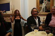 Suzanne and Anish Kapoor, PARTY AFTER THE OPENING OF THE ANISH KAPOOR EXHIBITION AT THE LISSON GALLERY. Duchess Palace, 16 Mansfield St. London. W1. 10 October 2006. -DO NOT ARCHIVE-© Copyright Photograph by Dafydd Jones 66 Stockwell Park Rd. London SW9 0DA Tel 020 7733 0108 www.dafjones.com