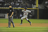 CHICAGO - SEPTEMBER 23:  Carlos Gomez #22 of the Minnesota Twins runs towards second base after hitting an RBI double in the fourth inning against the Chicago White Sox on September 23, 2009 at U.S. Cellular Field in Chicago, Illinois.  The Twins defeated the White Sox 8-6.  (Photo by Ron Vesely)