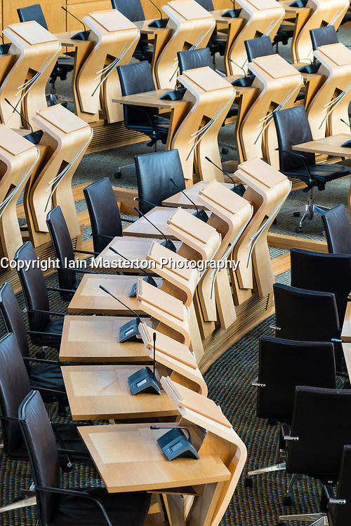 View of seating area for MSPs ( Members of Scottish Parliament) inside debating chamber at the Scottish Parliament building in Edinburgh, Scotland, United Kingdom