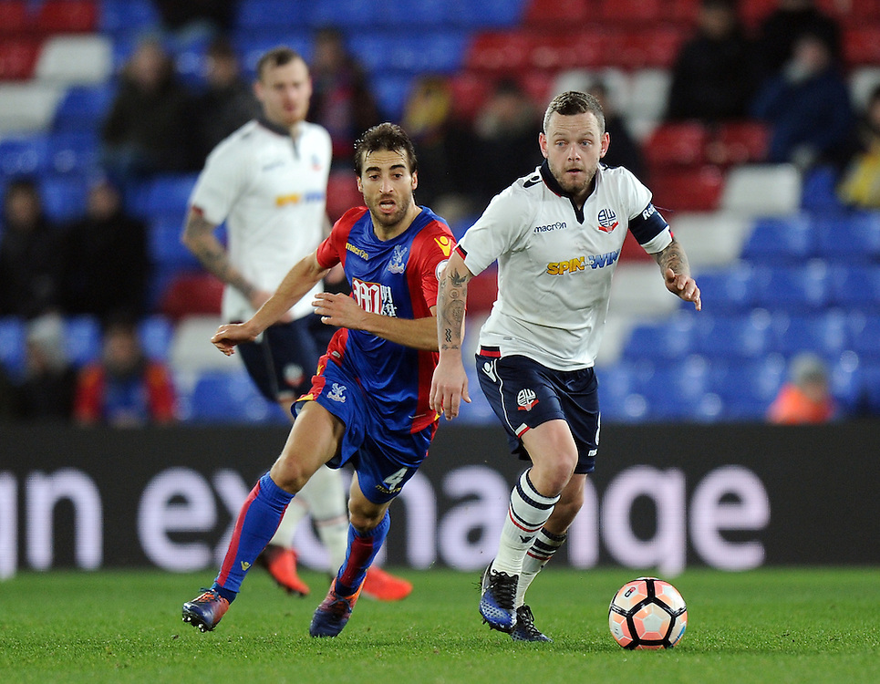 Bolton Wanderers' Jay Spearing holds off the challenge from Crystal Palace's Mathieu Flamini<br /> <br /> Photographer Ashley Western/CameraSport<br /> <br /> Emirates FA Cup Third Round Replay - Crystal Palace v Bolton Wanderers - Tuesday 17th January 2017 - Selhurst Park - London<br />  <br /> World Copyright © 2017 CameraSport. All rights reserved. 43 Linden Ave. Countesthorpe. Leicester. England. LE8 5PG - Tel: +44 (0) 116 277 4147 - admin@camerasport.com - www.camerasport.com