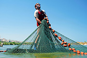 Israel, Coastal Plains, Kibbutz Maagan Michael, Harvesting fish from an intensive growing pool collecting the net and bringing the fish to the extraction tool.