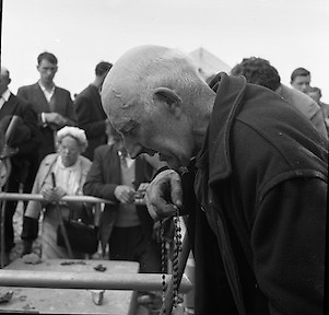 Between 50.000 and 60.000 pilgrims, young and old, from all parts of Ireland and abroad, climbed the rugged slopes of Croagh Patrick to take part in the annual pilgrimage.  Bare headed and deep in prayer, a pilgrim kneels on top of the Reek.<br /> <br /> 29th July 1962