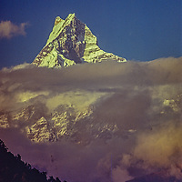 """Machhapuchhare Peak (""""The Fish Tail"""") rises above the Pokhara Valley in Nepal."""