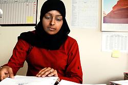 Female office worker in Bradford Housing Association; Yorkshire UK