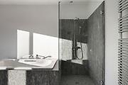 Interior, modern bathroom of an house, bathtub and shower