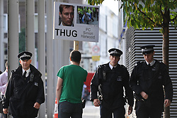 © Licensed to London News Pictures. 17/09/2012. London,UK.A man with banner.  PC Simon Harwood, who was cleared of killing Ian Tomlinson during the G20 protests, arrives at Empress State Building (not pictured) for a disciplinary hearing..Photo credit : Thomas Campean/LNP..