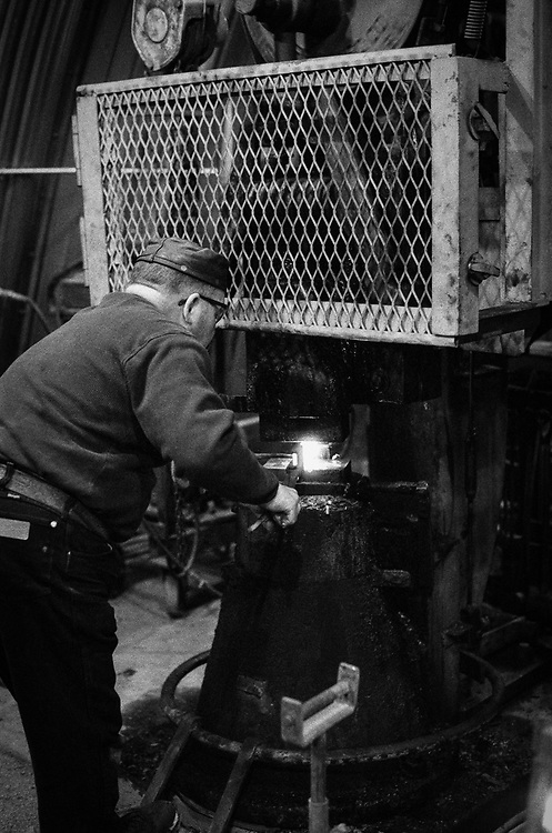 Hammering the steel into shape.