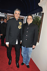 Left to right, fashion designers SANDEEP KHOSLA and ABU JANI at the launch of the India Fantastique Exhibition and book launch featuring photographs by Ram Shergill and fashion by India's leading couturiers Abu Jani and Sandeep Khosla held at Sotheby's, 34-35 New Bond Street, London on 5th September 2012.