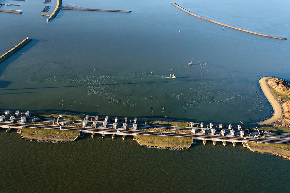 Nederland, Noord-Holland, Den Oever, 11-12-2013; begin Afsluitdijk met Stevinsluizen (spuisluizen). Waddenzee boven in beeld. er. <br /> beginning Enclosure Dam with Stevin Sluices. Waddenzee (top).<br /> luchtfoto (toeslag op standaard tarieven);<br /> aerial photo (additional fee required);<br /> copyright foto/photo Siebe Swart.