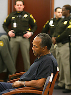 O.J. Simpson, former football great, appears in court for violating terms of his bail in Clark County District Court in Las Vegas January 16, 2008. Simpson's trial is scheduled for April 7th. REUTERS/Rick Wilking  (UNITED STATES)