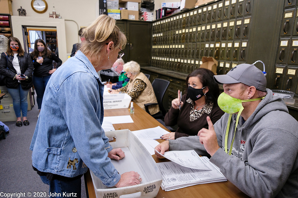 09 NOVEMBER 2020 - NEWTON, IOWA: TINA MULGREW, Deputy Auditor of Elections for Jasper County, talks to members of the 10-person audit board that is recounting 561 ballots by hand. The Jasper County (Iowa) auditor ordered a manual recount of 561 votes from Clear Creek Poweshiek precinct in Mingo after vote totals were incorrectly transcribed on a spreadsheet. The incorrect vote total tabulation could affect the outcome of the election for Iowa's second congressional district. The incorrect transcription awarded more votes to Republican Congressional candidate Mariannette Miller-Meeks than she actually won and changed the outcome of the race. The corrected totals changed 162 votes and put Rita Hart, the Democratic candidate in the lead by 282 votes. The race is one of the closest races for a Congressional seat.      PHOTO BY JACK KURTZ