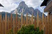 The Dolomites mountain Sassongher (2,665m) in the background with spiked fences in the town of Corvara during the summer walking season in south Tyrol, northern Italy. of the the Dolomites resort town of Corvara during the summer walking season in south Tyrol, northern Italy. Corvara is the main center of Alta Badia, a prestigious tourist area located at the top end of the Val Badia, surrounded by the peaks of the Dolomites mountains. Corvara (German: Corvara or Kurfar; Italian: Corvara in Badia) is a comune (municipality) in South Tyrol in northern Italy, located about 40 kilometres (25 mi) east of Bolzano.