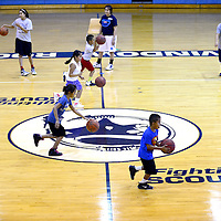 071013  Adron Gardner/Independent<br /> <br /> Basketball campers practice their drive dribbles at the Fort Defiance Field House in Fort Defiance Wednesday.