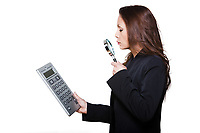 Portrait of woman with large calculator and magnifying glass in studio isolated on white background