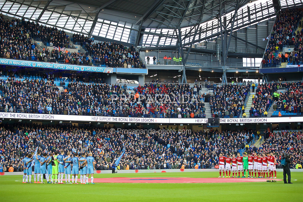 MANCHESTER, ENGLAND - Saturday, November 5, 2016: Manchester City and Middlesbrough players stand to remember those that gave their lives in the Great War, before the FA Premier League match at the City of Manchester Stadium. (Pic by David Rawcliffe/Propaganda)