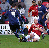 Photo: Dave Linney.<br />Walsall v Swindon Town. Coca Cola League 2. 09/12/2006.<br />Walsall's Michael Dobson(R) slides in on   Sofiane Zaaboub
