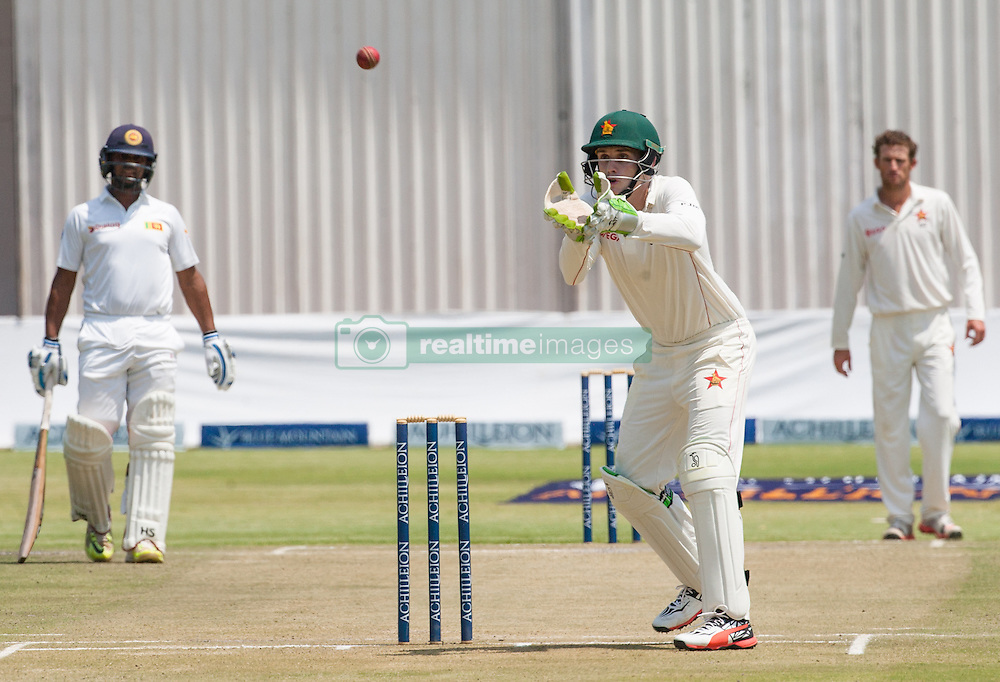 Zimbabwe wicket keeper Peter Moor fields a ball during the second day of the 100th test match for Zimbabwe played in a match with Sri Lanka at Harare Sports Club 30 October 2016.