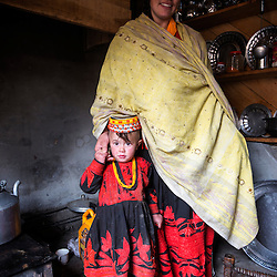 Bumburet, Chitral District,Pakistan.Pic Shows A Kalash woman and child in the Kalash village in the valley of Bumburet