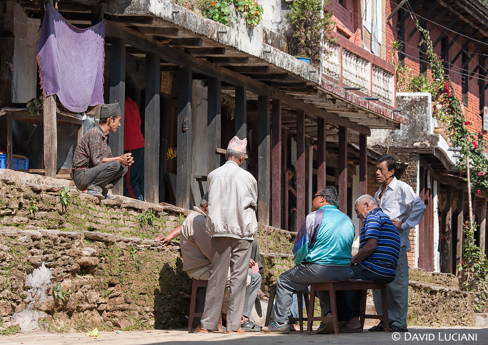 Men playing cards along the main street in Bandipur.
