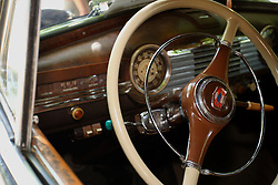 04 August 2012:  steering wheel and dash on a 1947 Chevrolet Fleetline Sport Sedan on display at the McLean County Antique Automobile Club Show at the David Davis Mansion, Bloomington IL