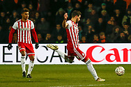 Brentford defender Yoann Barbet (29) hits the ball on the rebound during The FA Cup fourth round match between Barnet and Brentford at The Hive Stadium, London, England on 28 January 2019.