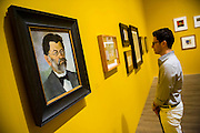 Tate Modern's new exhibition, of the avant-garde work of Russian Kazimir Malevich. Here his early works from 1900-11 including Portrait of Artists Father, left. Tate Modern, Bankside, London, UK.