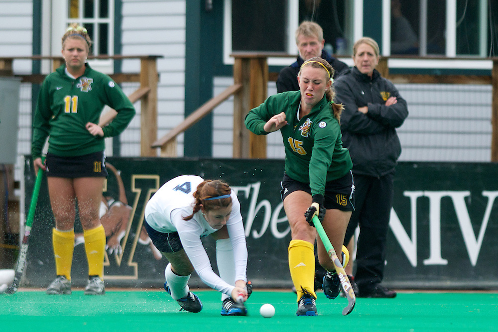 Catamounts midfielder Aria Robinson (15) tries to block a shot during the women's field hockey game between the Maine Black Bears and the Vermont Catamounts at Moulton/Winder Field on Saturday afternoon September 29, 2012 in Burlington, Vermont.